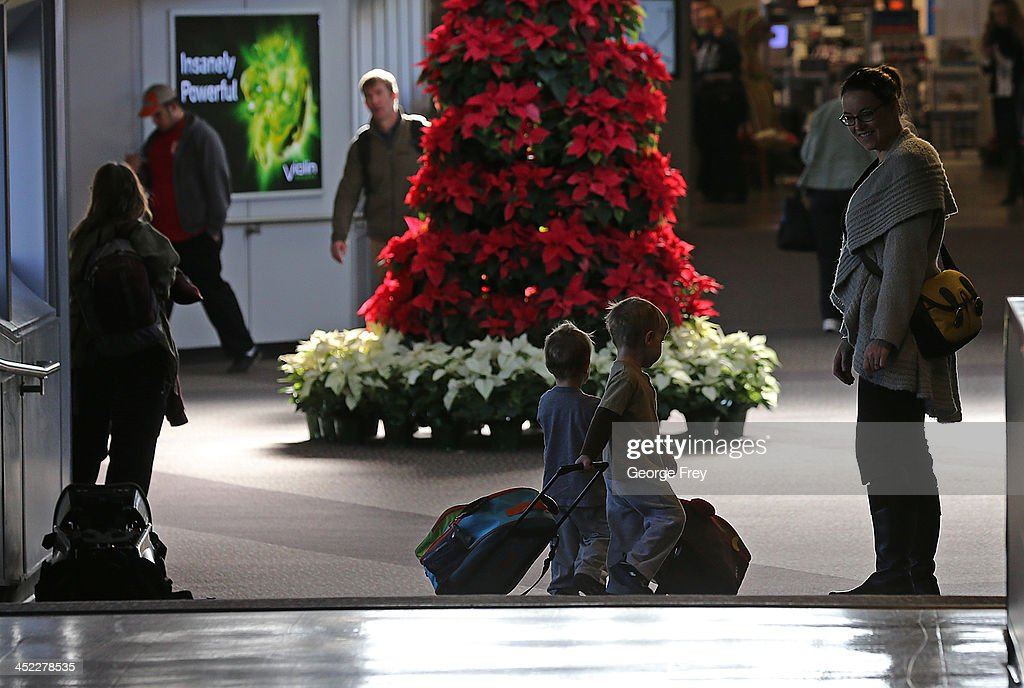 A mom and her two boys make their way through the Salt Lake City international Airport on November 27, 2013 in Salt Lake City, Utah. A wintry storm system that is covering much of the nation is threatening to wreak havoc on holiday travel .