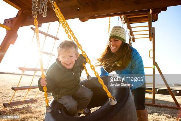 Mom and son laughing with excitement.