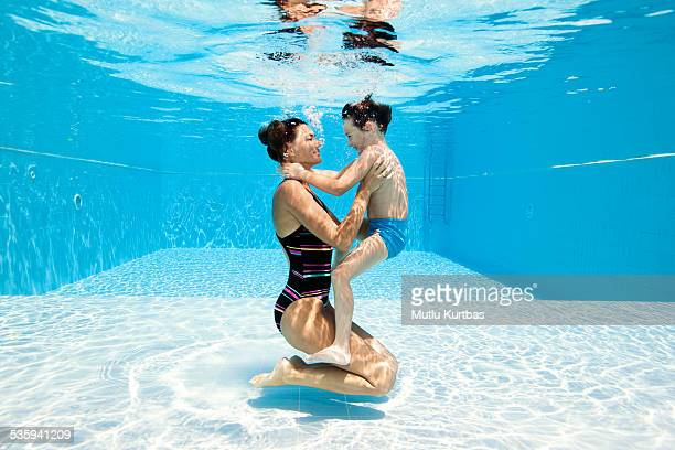 Mom and son playing in the swimming pool