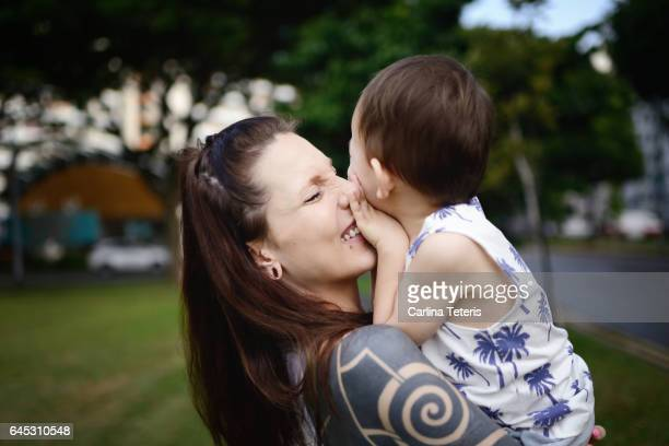 Mom and son playing outdoors near a street