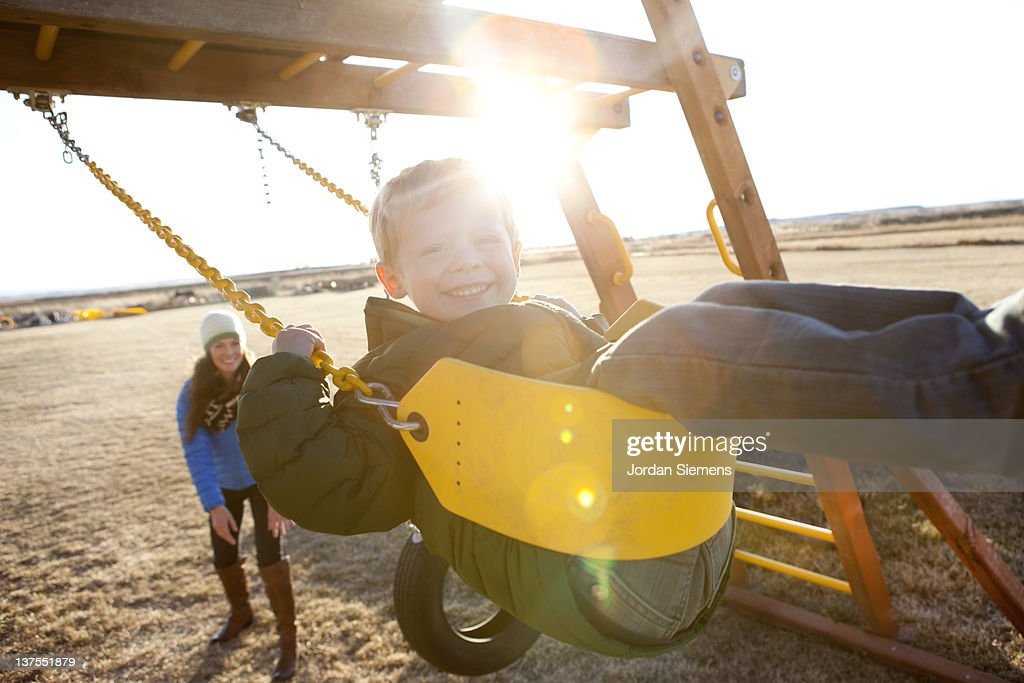 Mom and son playing outdoors. : Stock Photo