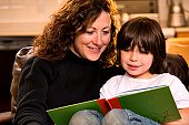 Mom and son reading a book.
