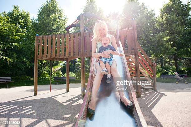 Mom and son sliding
