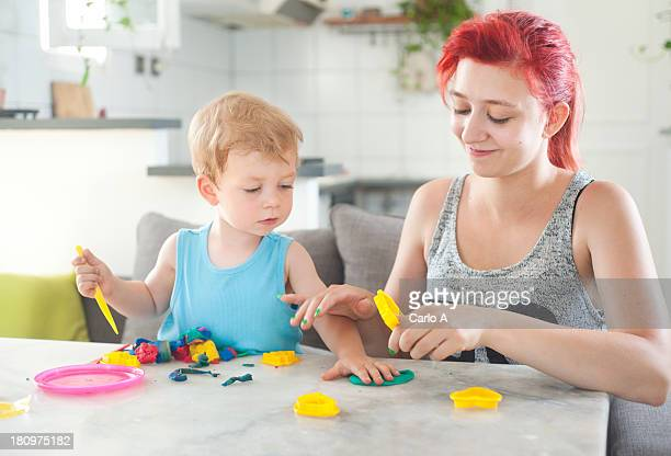 Mom and son with clay dough