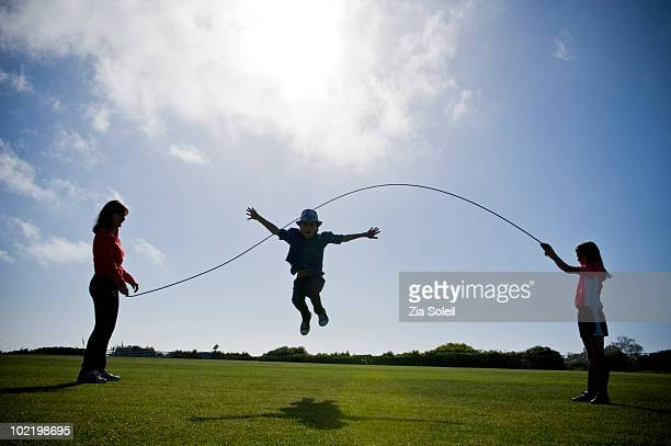 Mom and two kids playing jump rope