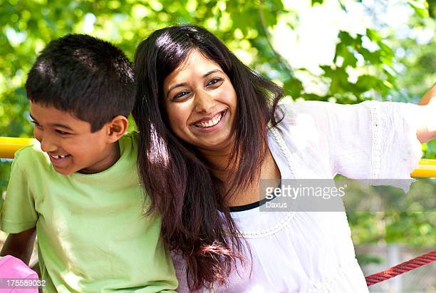 Mom and Young Boy at a Playground