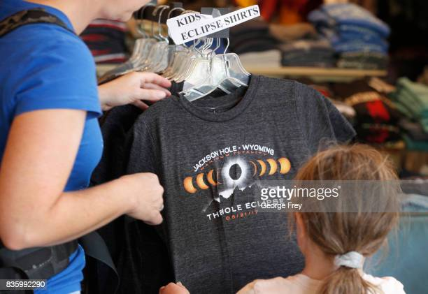 A mom buys one of the last solar eclipse shirts left for her daughter on August 20 2017 in Jackson Wyoming People are flocking to the Jackson and...