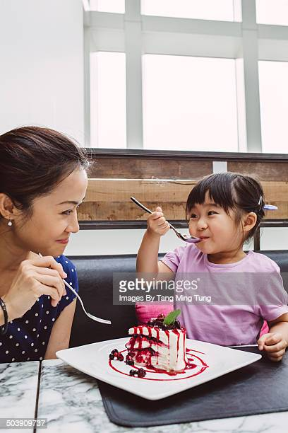 Mom & child having dessert in restaurant