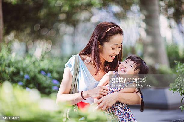 Mom & child playing joyfully in park