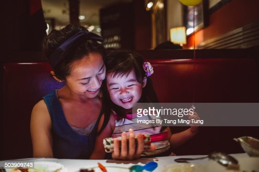 Mom & child using smartphone joyfully