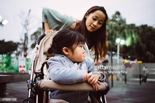 Mom comforting grumpy/upset baby in the park
