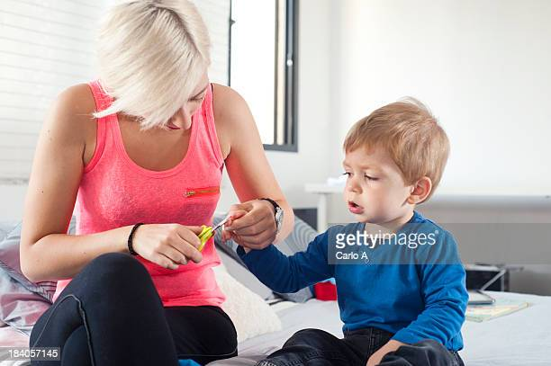 Mom cutting fingernails