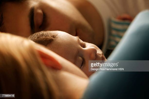 'Mom, Dad and baby sleeping'