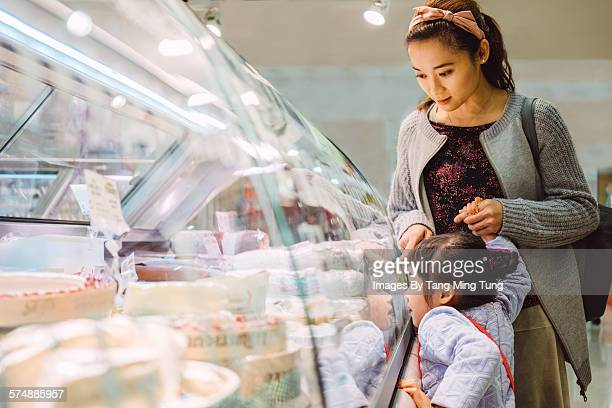 Mom & daughter shopping in supermarket