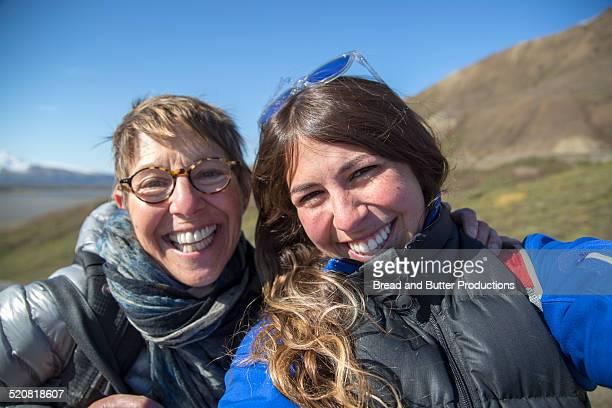 Mom & Daughter taking selfie on adventure trip