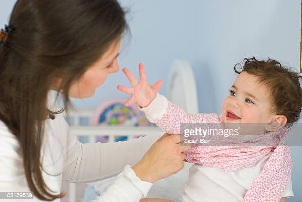 Mom Dressing Daughter