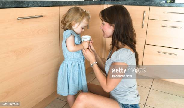 mom help the daughter to drink