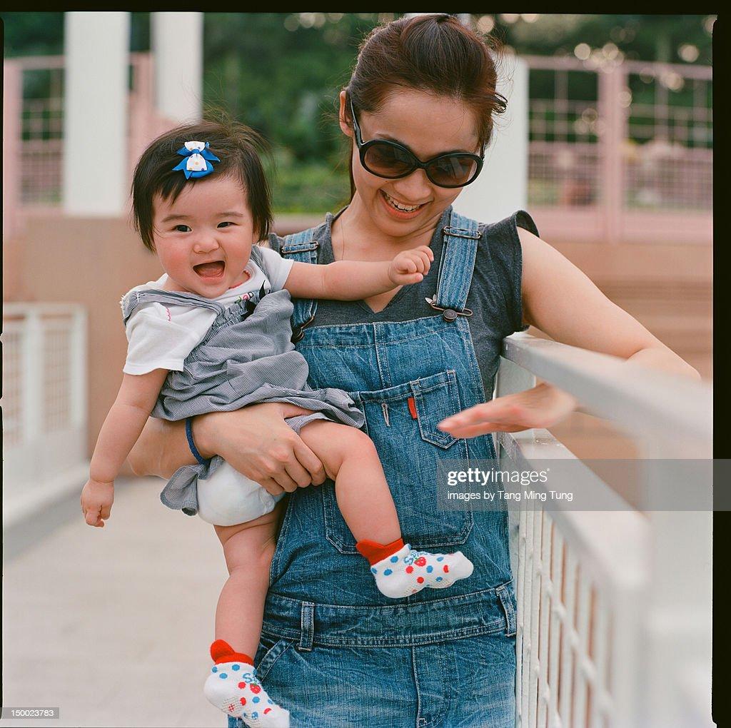 Mom holding baby girl : Stock Photo