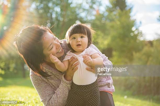 Mom Holding Her Little Baby Girl
