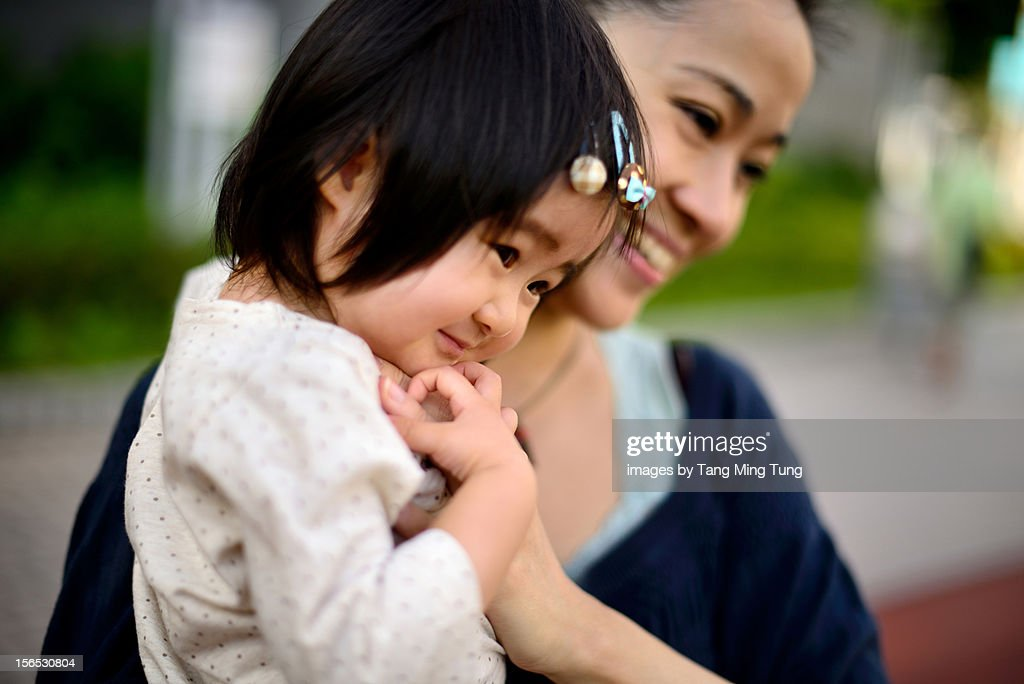 Mom holding smiling baby with love and affection : Stock Photo