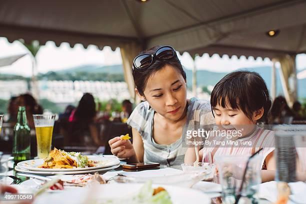 Mom & little girl enjoying outdoor lunch