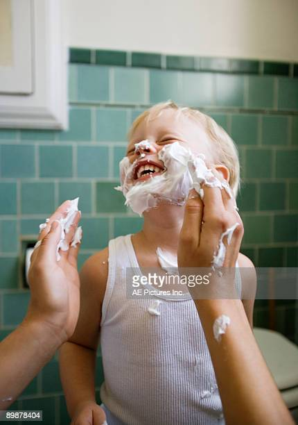 mom puts shaving cream on son