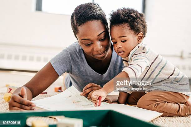 Mom reading for toddler
