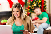 Mom shops online during the holidays