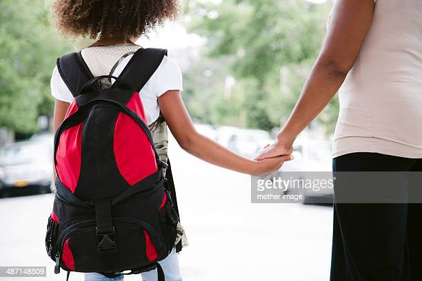 Mom taking daughter to school