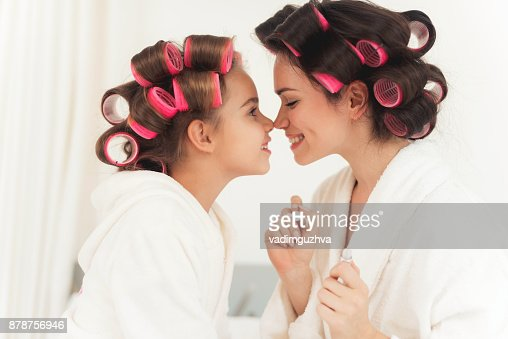 Mom Teaches A Little Daughter To Do Makeup Stock Photo