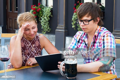 Mom Teaches Son To Use Tablet Stock Photo