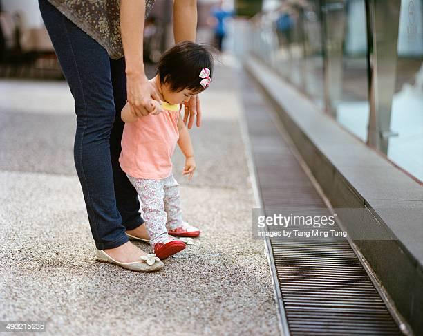 Mom teaching baby to walk