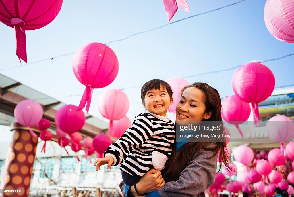Mom & toddler girl looking at the Chinese lanterns