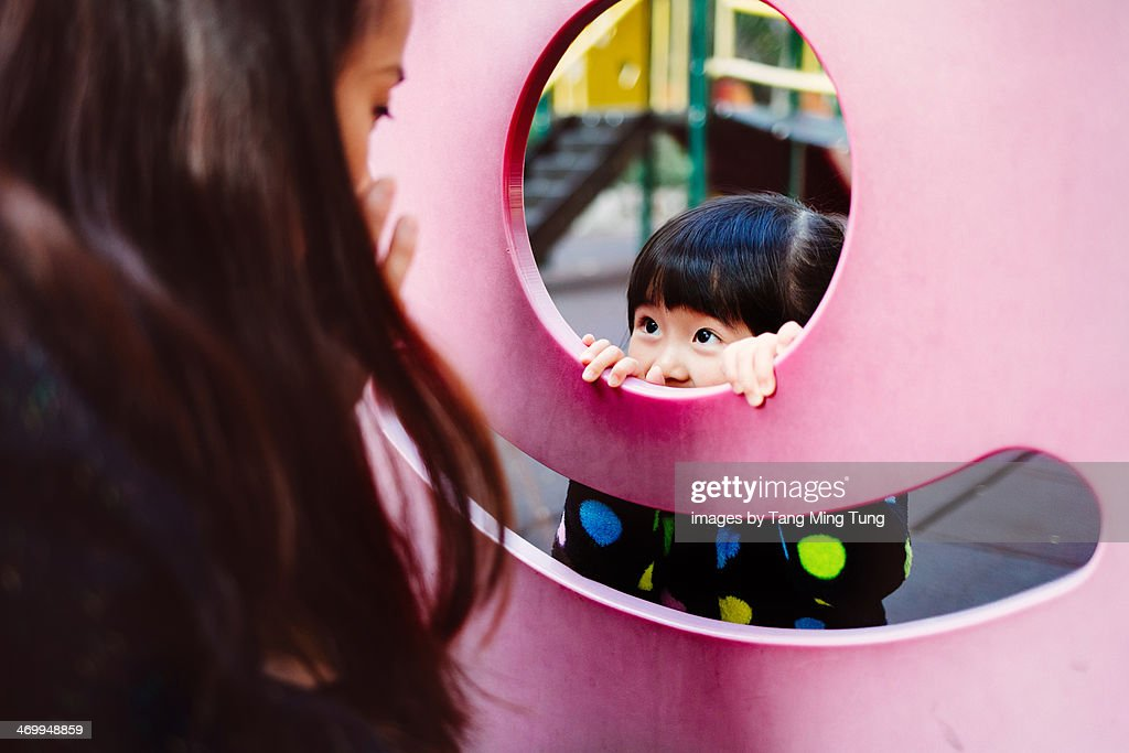 Mom & toddler girl playing in the playground : Stock Photo