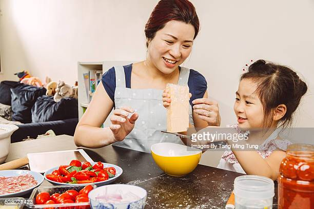 Mom & toddler making pizza joyfully together