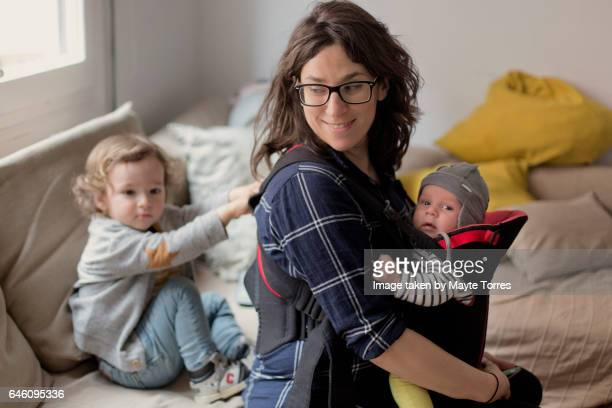 Mom with baby boys at home