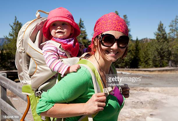 Mom with baby daughter in backpack carrier