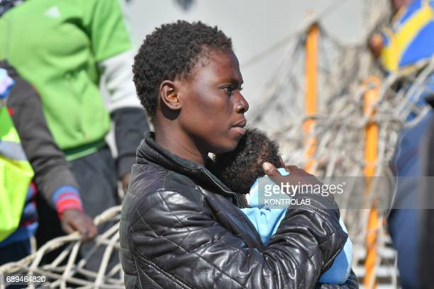 A mom with her baby during the landing of migrants by Turkish cargo ship Kaptan Hilmi III in port of Corigliano Calabria southern Italy The refugees...