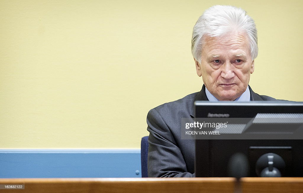 Momcilo Perisic, the former chief of staff of the Yugoslav army, sits during his appeal judgement in the court room of the Yugoslav War Crimes Tribunal (ICTY) in The Hague on February 28, 2013. Former Ivory Coast president Laurent Gbagbo is expected to address the International Criminal Court on the final day of hearings from 1330 GMT to decide whether he should face trial for crimes against humanity during the bloody 2010-2011 election standoff. AFP PHOTO / POOL - KOEN VAN WEEL