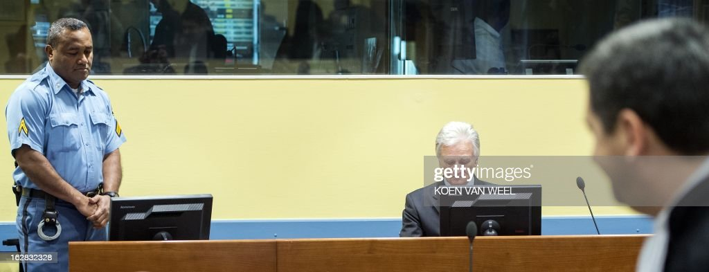 Momcilo Perisic (C), the former chief of staff of the Yugoslav army, sits during his appeal judgement in the court room of the Yugoslav War Crimes Tribunal (ICTY) in The Hague on February 28, 2013. Former Ivory Coast president Laurent Gbagbo is expected to address the International Criminal Court on the final day of hearings from 1330 GMT to decide whether he should face trial for crimes against humanity during the bloody 2010-2011 election standoff.