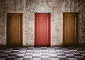 moment of doubt in choosing a door. Business concept and smart choices