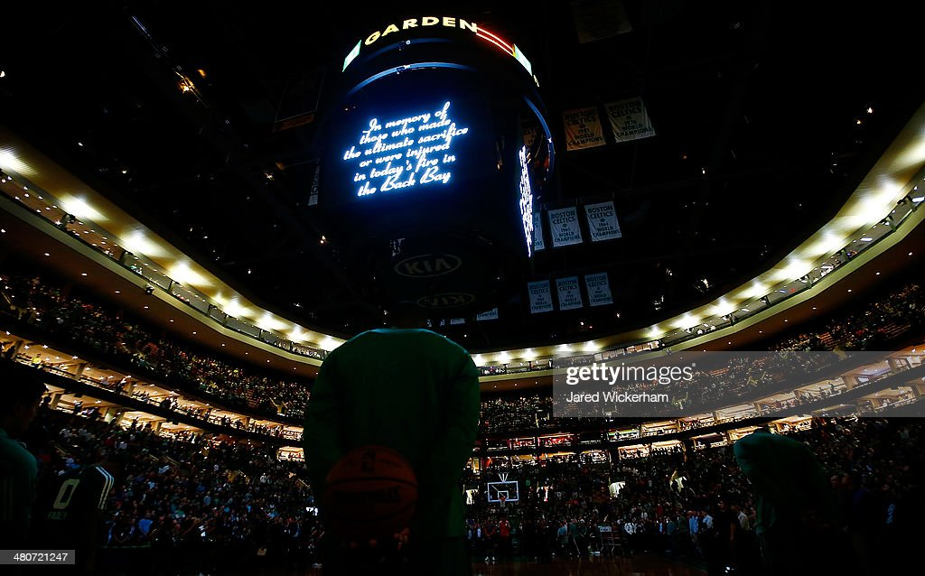 A moment of silence is had prior to the game between the Boston Celtics and the Toronto Raptors in memory of the firefighters whose lives were lost battling a 9-alarm fire in the Back Bay neighborhood earlier in the day during the game at TD Garden on March 26, 2014 in Boston, Massachusetts.