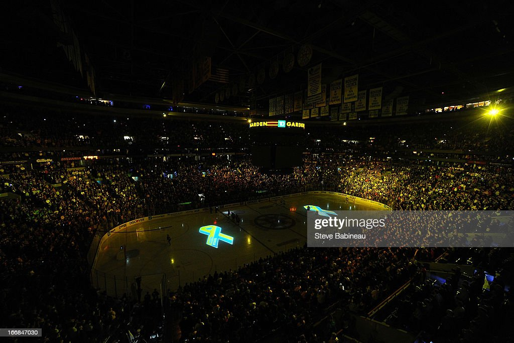 A moment of silence is held in honor of the Boston Marathon tragedy before the game of the Boston Bruins against the Buffalo Sabres at the TD Garden on April 17, 2013 in Boston, Massachusetts.