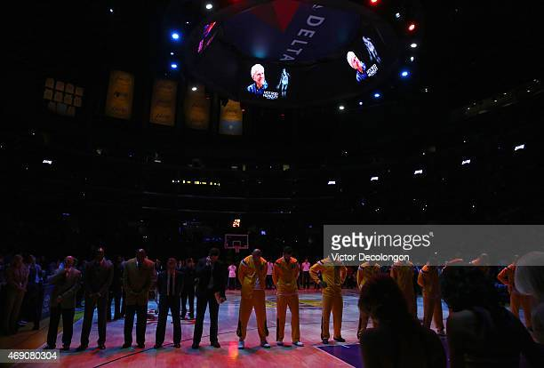 A moment of silence is observed to commemorate the passing of former Lakers player Rodney Clark 'Hot Rod' Hundley prior to the NBA game between the...