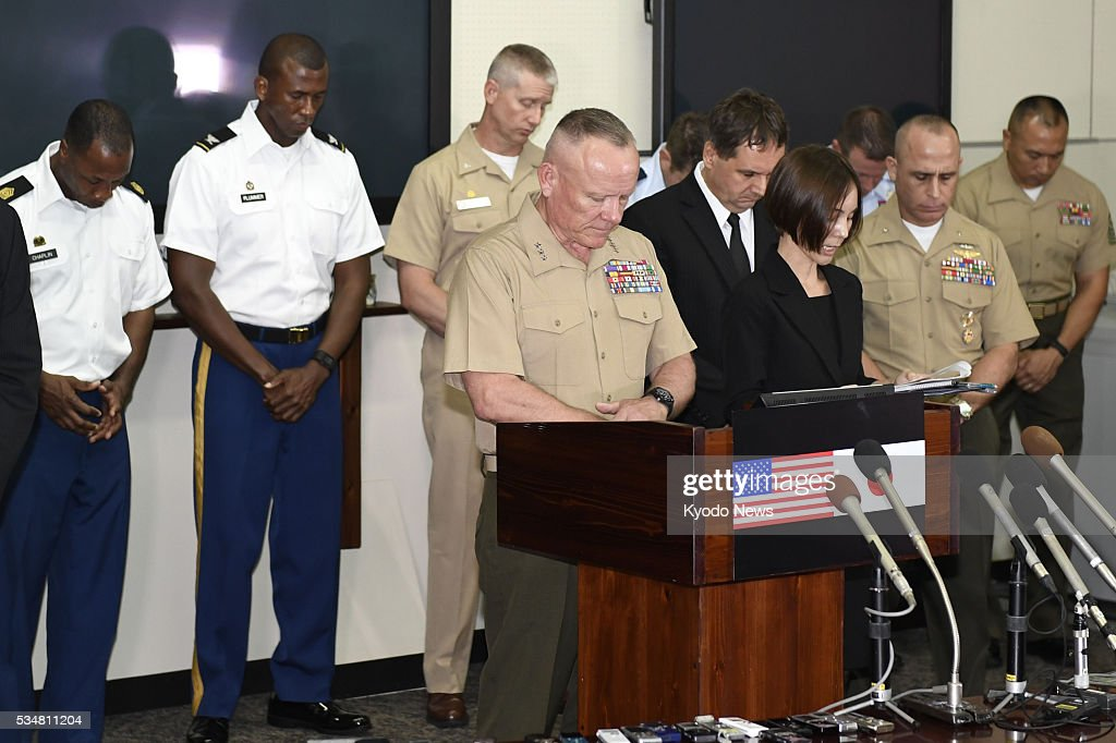A moment of silence is observed to mourn the death of a 20-year-old Japanese woman, at a press conference at Camp Foster in Okinawa Prefecture on May 28, 2016. Lt. Gen. Lawrence Nicholson (C front) expressed his shock and regret at the incident over which an American base worker, who is a former Marine, has been arrested, and explained measures to tighten discipline among U.S. forces.
