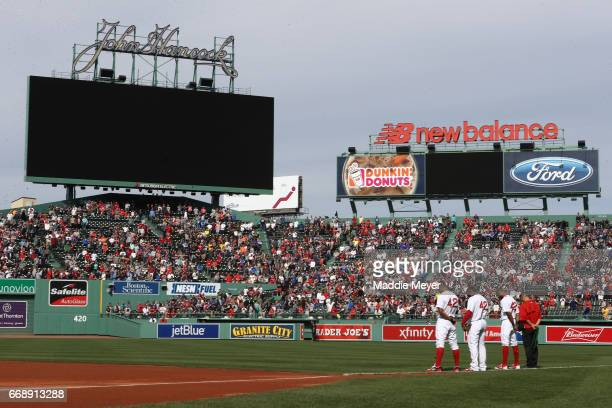A moment of silence is observed to recognize the four year anniversary of the Boston Marathon bombings before the game between the Boston Red Sox and...