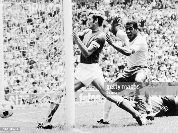 A moment of triumph for Brazil's Jairzinho as he scores a third goal during the World Cup Championship against Italy To his left is Giacinto...