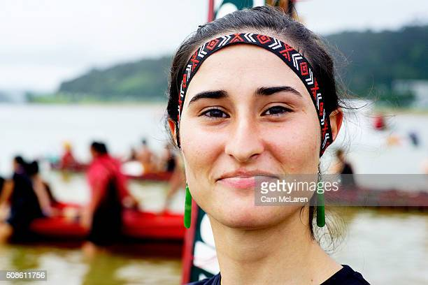 A moment on the beach after bringing in her Waka on February 6 2016 in Waitangi New Zealand The Waitangi Day national holiday celebrates the signing...