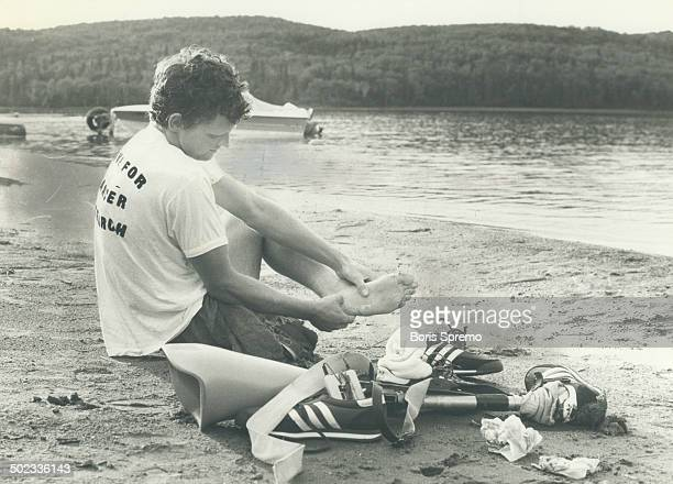 Moment's rest Terry Fox takes a break near Marathon Ont during long hard week of running