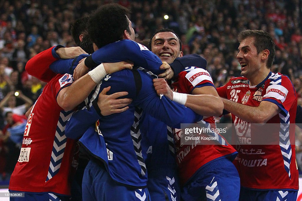 Momir Ilic, Darko Stanic, Alem Toskic and Dalibor Cutura of Serbia celeebrate the26-22 victory after the Men's European Handball Championship second semi final match between Serbia and Croatia at Beogradska Arena on January 27, 2012 in Belgrade, Serbia.